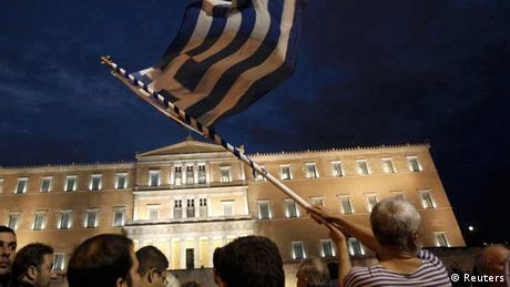 Greek parliamentary building, Greek flag (Reuters)