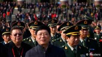 Military delegates leave the Great Hall of the People, the venue of the 18th National Congress of the Communist Party of China, after the opening ceremony, in Beijing, November 8, 2012. REUTERS/David Gray (CHINA - Tags: POLITICS)