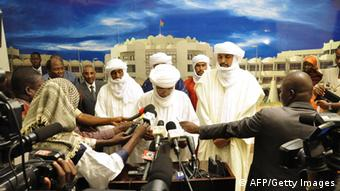 A delegation of Islamist group occupying northern Mali, Ansar Dine, speak to the press . AFP PHOTO / Yempabou Ahmed OUOBA