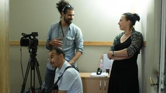 Anne Hoffmann and Selim Harbi filming on location.