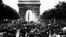 28th August 1944: Through the cheering crowds, General Charles de Gaulle leaves the Arc de Triomphe on his way to the Place de La Concorde, during the celebrations which marked the Liberation of Paris from Nazi rule. (Photo by Keystone/Getty Images)