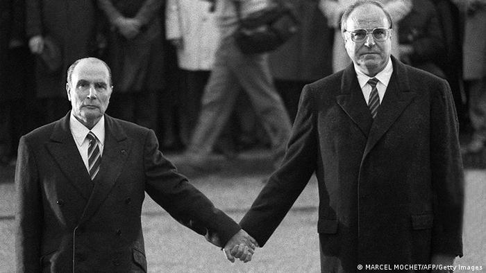 Helmut Kohl stands with Francois Mitterrand in Verdun in 1984