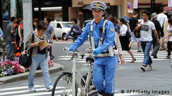 A police officer patrol at the Ginza shopping district in Tokyo TOSHIFUMI KITAMURA/AFP/GettyImages