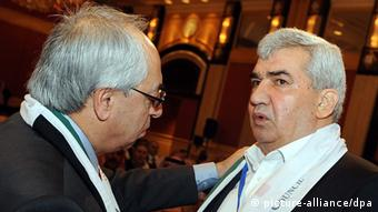 Head of the opposition Syrian National Council (SNC) Abdel Basset Sayda (left) speaks with prominent dissident Riad Seif EPA/STRINGER +++(c) dpa - Bildfunk+++