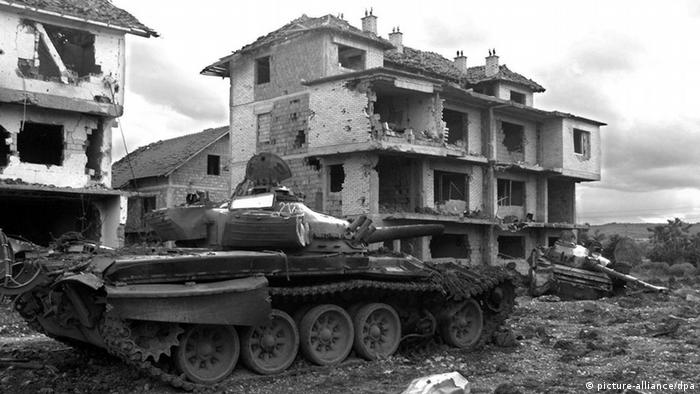 Russian tanks of the Yugoslav Army sit abandoned on Saturday, 19 June 1999 in the eastern Kosovar village of Klina after having been destroyed by NATO air strikes. The NATO international peacekeeping force for Kosovo (KFOR) confirmed 20 June 1999 that Yugoslav troops had completed their withdrawal from the Yugoslav province. dpa (Digitale Fortografie)