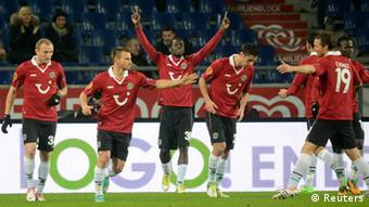 Hanover 96's Mame Diouf (C) celebrates with his team mates after scoring during the Europa League Group L soccer match against Helsingborg in Hanover, November 8, 2012. REUTERS/Fabian Bimmer (GERMANY - Tags: SPORT SOCCER)