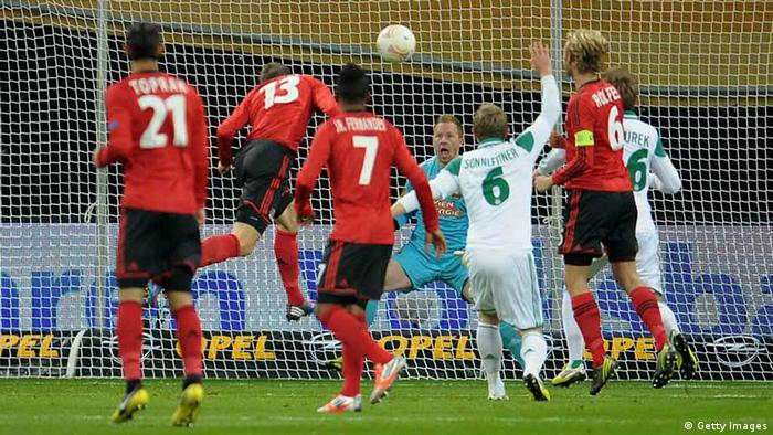 LEVERKUSEN, GERMANY - NOVEMBER 08: Jens Hegeler of Leverkusen heads his team's first goal during the UEFA Europa League Group K match between Bayer 04 Leverkusen and SK Rapid Wien at BayArena on November 8, 2012 in Leverkusen, Germany. (Photo by Dennis Grombkowski/Bongarts/Getty Images)