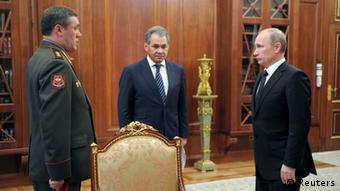 Russian President Vladimir Putin (R) speaks with newly appointed armed forces Chief-of-Staff Valery Gerasimov (L) and Defence Minister Sergei Shoigu during their meeting in Moscow's Kremlin November 9, 2012. REUTERS/Alexsey Druginyn/RIA Novosti/Pool (RUSSIA - Tags: MILITARY POLITICS) THIS IMAGE HAS BEEN SUPPLIED BY A THIRD PARTY. IT IS DISTRIBUTED, EXACTLY AS RECEIVED BY REUTERS, AS A SERVICE TO CLIENTS