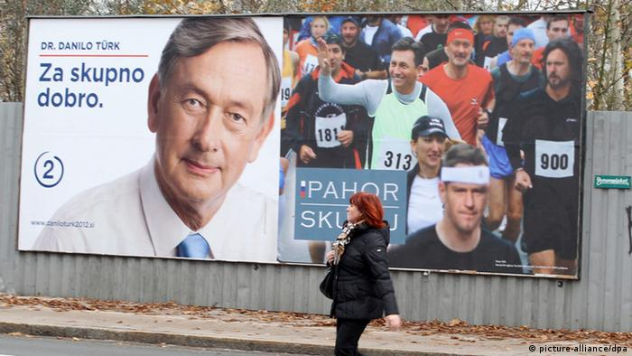 epa03463145 A woman walks past Danilo Tuerk and Borut Pahor campaign posters in Ljubljana, Slovenia, 08 November 2012. The country will hold Presidential elections on 11 November. Tuerk, the incumbent president, is seeking re-election for the second term as an independent candidate. Former Prime Minister Pahor is running for president with the support from Social Democrats and the Civic List, a Conservative Liberal party in the Slovenian center-right government coalition. EPA/STR +++(c) dpa - Bildfunk+++