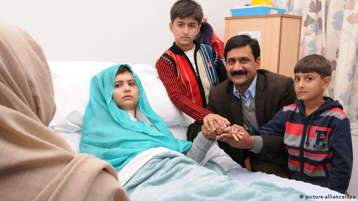 Malala Yousufzai, who is recovering in Queen Elizabeth Hospital in Birmingham, Britain, with parents and brothers (EPA/UNIVERSITY HOSPITALS BIRMINGHAM NHS FOUNDATION TRUST HANDOUT HANDOUT)