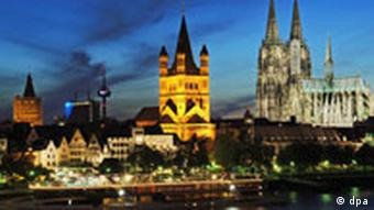 The Cologne skyline, including the cathedral and other churches, at night