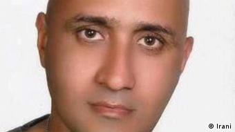 A modern Iranian man with a shaved head and no beard looks into the camera without smiling (Photo: Irani)