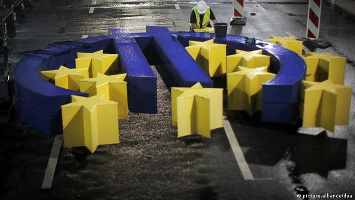 A large euro symbol on the ground as repairs are made