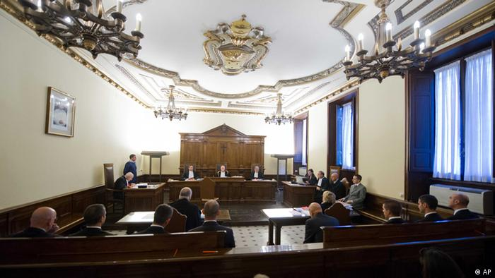 The wood-trimmed courtroom of the tiny Vatican tribunal