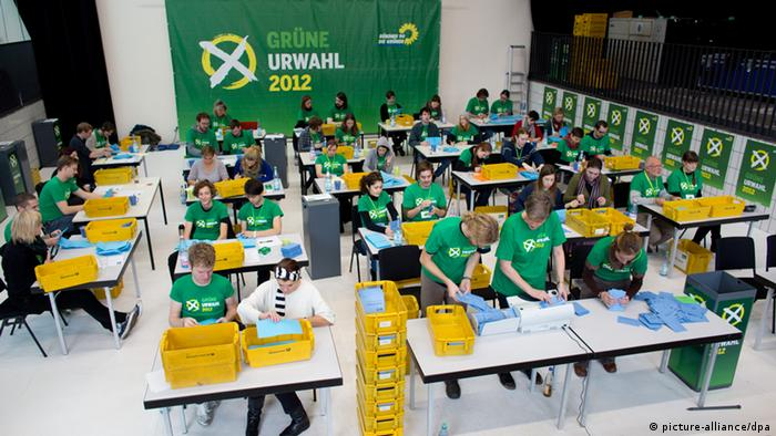 Green Party members count votes from the direct voting initiative