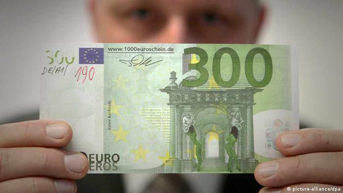 Man inspecting a forged euro banknote