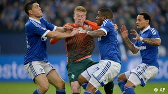 Bremen's Kevin De Bruyne of Belgium challenges for the ball with Schalke's Kyriakos Papadopoulos, Jefferson Farfan and Jermaine Jones