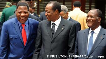 Burkina's President Blaise Compaore (C) together with Benin's President Boni Yayi (L) and Ivorian President Alassane Ouattara. (Photo: PIUS UTOMI EKPEI/AFP/Getty Images)