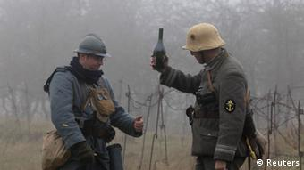 Close-up of two volunteers dressed in French and German WWI military outfits re-enact fraternizing on Armistice Day, at the military battlefield museum (Photo: REUTERS/Pascal Rosssignol)