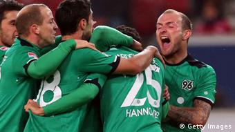 STUTTGART, GERMANY - NOVEMBER 11: Mohammed Abdellaoue (2nd R) of Hannover celebrates scoring the 4th team goal with his team mates during the Bundesliga match between VfB Stuttgart and Hannover 96 at Mercedes-Benz Arena on November 11, 2012 in Stuttgart, Germany. (Photo by Alexander Hassenstein/Bongarts/Getty Images)
