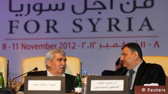Leading Syrian dissident Riad Seif (L) speaks with former Syrian Prime Minister Riyad Hijab, who defected from the Assad regime, during the General Assembly of the Syrian National Council in Doha November 11, 2012. Syria's fractious opposition finally put aside fierce arguments to rally behind a new leader within a new coalition that its Western and Arab backers hope can topple Bashar al-Assad and take over the country. REUTERS/Mohammed Dabbous (QATAR - Tags: POLITICS CIVIL UNREST)