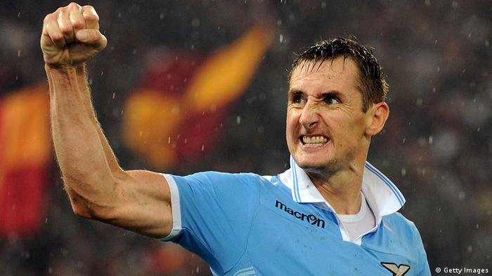 ROME, ITALY - NOVEMBER 11: Miroslav Klose of Lazio celebrates after scoring the 2-1 goal during the Serie A match between S.S. Lazio and AS Roma at Stadio Olimpico on November 11, 2012 in Rome, Italy. (Photo by Giuseppe Bellini/Getty Images)