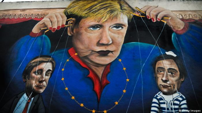 Picture taken in Lisbon on November 9, 2012 shows a graffiti depecting German Chancellor Angela Merkel handling string puppets of Portuguese Prime Minister Pedro Passos Coelho (L) and Portugal's Foreign Minister Paulo Portas (R). German Chancellor Angela Merkel will visit Lisbon on November 12, 2012. AFP PHOTO / PATRICIA DE MELO MOREIRA (Photo credit should read PATRICIA DE MELO MOREIRA/AFP/Getty Images)