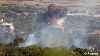 Fire and smoke rise after shells exploded in the Syrian village of Bariqa, close to the ceasefire line between Israel and Syria, near Alonei Habashan on the Israeli occupied Golan Heights November 7, 2012. (Photo: REUTERS/Baz Ratner)
