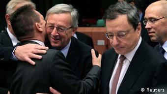 Euro Group chairman Jean-Claude Juncker (center) greets Greece's Finance Minister Yannis Stournaras (l), while European Central Bank (ECB) President Mario Draghi (second from right) looks on at a Euro Group meeting in Brussels in November, 2012. Copyright: REUTERS/Yves Herman