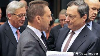 Jean-Claude Juncker, Yannis Stournaras and Draghi AFP PHOTO GEORGES GOBET (Photo credit should read GEORGES GOBET/AFP/Getty Images)