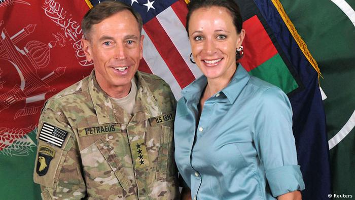 Commander of the International Security Assistance Force/US Forces in Afghanistan General David Petraeus shakes hands with author Paula Broadwell in this ISAF handout photo (Photo: REUTERS/ISAF/Handout)