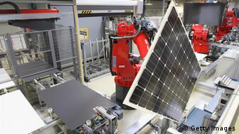 PRITZWALK, GERMANY - SEPTEMBER 12: Robots at the Aleo factory assembles solar panels that will convert light from the sun into electricity on September 12, 2012 in Pritzwalk, Germany. Aleo, which is owned by German engineering group Bosch, is fairing better than many of its competitors but a spokesman admitted the company is also suffering from the gradual reduction of the feed-in compenstation rates set by the German government, which gurantee fixed prices for electricity delivered into the German electricity grid. Several other solar industry firms in eastern Germany, including Q.Cells, Sovello and Solarwatt AG, have gone into bankruptcy this year. Aleo mainly produces solar panels installed on the roofs of residential houses. (Photo by Sean Gallup/Getty Images)