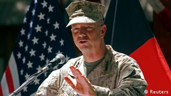 U.S. General John Allen, commander of the North Atlantic Treaty Organization (NATO) forces in Afghanistan, speaks during U.S. Independence Day celebrations in Kabul, in this file picture taken July 4, 2012. Allen, the top U.S. commander in Afghanistan, is under investigation for alleged inappropriate communication with Jill Kelley, a woman at the center of the scandal involving former CIA Director David Petraeus, a senior U.S. defense official said on November 13, 2012. REUTERS/Mohammad Ismail/Files (AFGHANISTAN - Tags: MILITARY POLITICS)