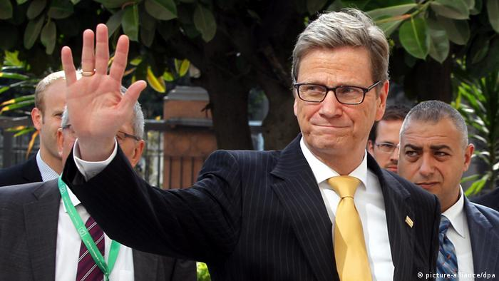 German Foreign Minister Guido Westerwelle waves to photographers as he arrives for a meeting at a conference held jointly by the EU and the Arab League in Cairothis month Copyright: EPA/KHALED ELFIQI