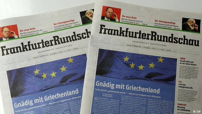 Two copies of Tuesday's edition showing the FR's banner and an EU flag. Photo: DW/ Per Henriksen 13.11.2012 DW2_9608.