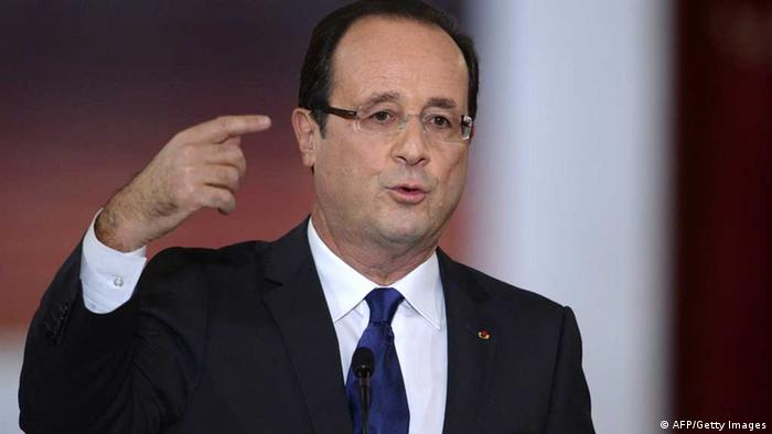 French President Francois Hollande speaks during his first major press conference at the Elysee Place in Paris on November 13, 2012