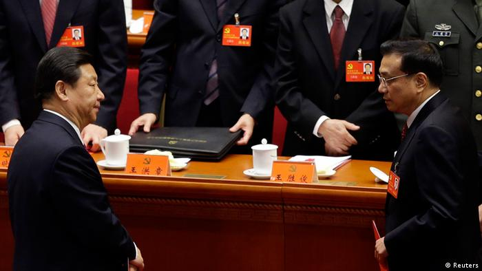 China's Vice President Xi Jinping (front L) and China's Vice-Premier Li Keqiang (front R) leave their seats after the closing session of 18th National Congress of the Communist Party of China at the Great Hall of the People in Beijing, November 14, 2012. China's Communist Party congress offered the first clues on a generational leadership change on Wednesday as Xi Jinping and Li Keqiang took the first step to the presidency and premiership, respectively. The 2,270 carefully vetted delegates cast their votes behind closed doors in Beijing's cavernous Great Hall of the People for the new Central Committee, a ruling council with around 200 full members and 170 or so alternate members with no voting rights. REUTERS/Jason Lee (CHINA - Tags: POLITICS)