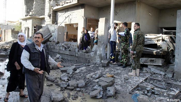 Residents inspect the site of a car bomb attack in Kirkuk (Photo: Reuters)