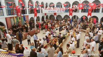 (FILES) Picture dated 11 May 2001 of Jewish pilgrims in Djerba synagogue. Five people were killed and 20 were injured when a truck transporting gas exploded 11 April 2002 outside the ancient Ghriba synagogue on the Tunisian island of Djerba in what an official said was an accident. dpa