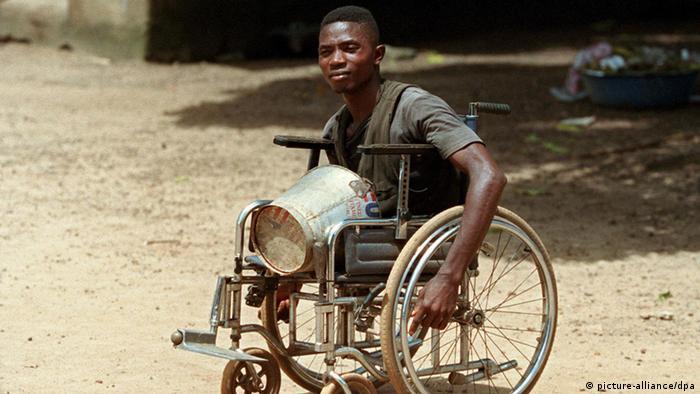 A victim of Sierra Leone's civil war in a wheelchair