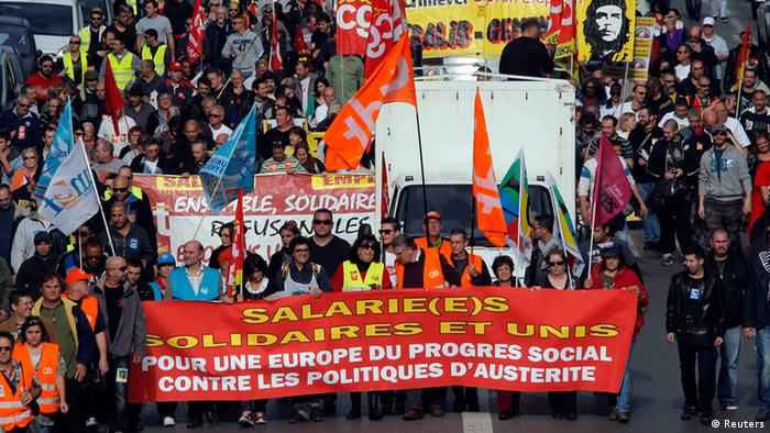 People take part in a demonstration by French labour unions against austerity policies in Europe, in Marseille November 14, 2012. The banner in front reads: Workers solidarity and unity - for an Europe of social progress against austerity policies. REUTERS/Jean-Paul Pelissier (FRANCE - Tags: POLITICS BUSINESS CIVIL UNREST)
