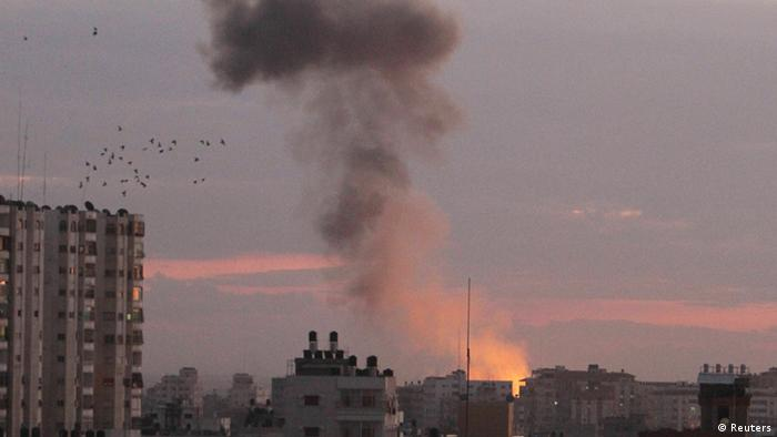 Smoke rises following Israeli air strikes in Gaza City November 14, 2012.