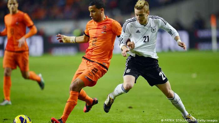 German midfielder Marco Reus (R) and Dutch defender Ricardo van Rhjin vie for the ball during the friendly football match Netherlands vs Germany on November14, 2012 in Amsterdam, Netherlands. AFP PHOTO / PATRIK STOLLARZ (Photo credit should read PATRIK STOLLARZ/AFP/Getty Images)