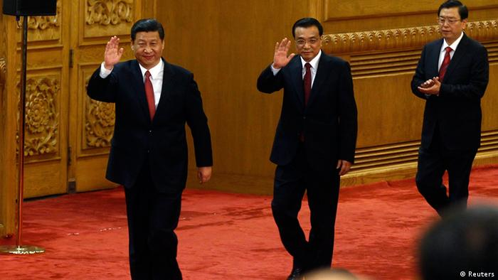 China's new Politburo Standing Committee members (from L to R) Xi Jinping, Li Keqiang and Zhang Dejiang wave as they arrive to meet with the press at the Great Hall of the People in Beijing, November 15, 2012. China's ruling Communist Party unveiled its new leadership line-up on Thursday to steer the world's second-largest economy for the next five years, with Vice President Xi Jinping taking over from outgoing President Hu Jintao as party chief. tREUTERS/Carlos Barria (CHINA - Tags: POLITICS)