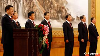 Newly-elected General Secretary of the Central Committee of the Communist Party of China (CPC) Xi Jinping (L) speaks as he meets with the press with other new Politburo Standing Committee members (from 2nd L to R) Zhang Gaoli, Liu Yunshan, Zhang Dejiang, Li Keqiang, Yu Zhengsheng and Wang Qishan at the Great Hall of the People in Beijing, November 15, 2012. China's ruling Communist Party unveiled its new leadership line-up on Thursday to steer the world's second-largest economy for the next five years, with Vice President Xi Jinping taking over from outgoing President Hu Jintao as party chief. REUTERS/Carlos Barria (CHINA - Tags: POLITICS)