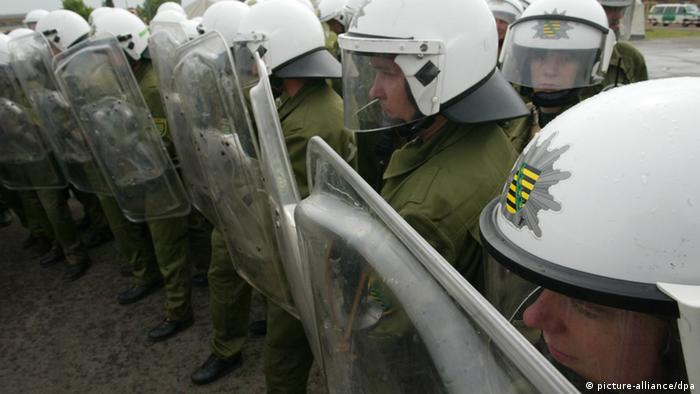 Police with protective shields near the conference (Jens Wolf/dpa)