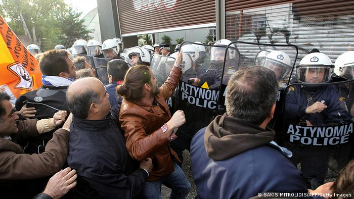 Municipal workers clash with riot police during a demonstration against the presence of German Deputy Labor minister Hans-Joachim Fuchtel in Thessaloniki on 15 November, 2012. Protesters reportedly attempted to break into the conference center that would host a meeting between Greek and German mayors. The protest came after Fuchtel, who is also German Chancellor Angela Merkel's special envoy to Greece, told journalists in the northern port city that it takes 3,000 Greek municipal workers to do the work of 1,000 of their German counterparts. AFP PHOTO /Sakis Mitrolidis (Photo credit should read SAKIS MITROLIDIS/AFP/Getty Images)