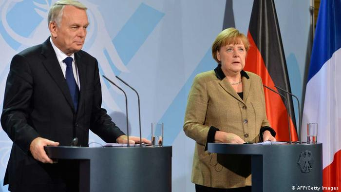 German Chancellor Angela Merkel (R) and French Prime Minister Jean-Marc Ayrault address a press conference at the chanellery in Berlin on November 15, 2012. (Photo via AFP)