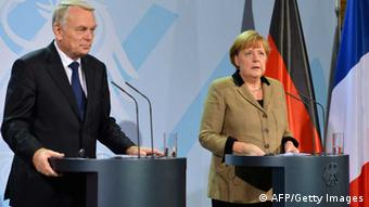 German Chancellor Angela Merkel (R) and French Prime Minister Jean-Marc Ayrault address a press conference at the chanellery in Berlin on November 15, 2012. Ayrault is on his first official trip to Germany, seeking to smooth tensions over economic policy between the two neighbours which have historically driven Europe forward. AFP PHOTO / ODD ANDERSEN (Photo credit should read ODD ANDERSEN/AFP/Getty Images)
