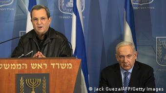 Israeli Defense Minister Ehud Barak (L) and Prime Minister Benjamin Netanyahu (R) address the media at the defense ministry in Tel Aviv on November 14, 2012. Israel sent a clear message to Hamas through the killing of its top military commander and is ready to 'expand' its operation in Gaza if necessary, Israeli Prime Minister Benjamin Netanyahu said . Photo: AFP PHOTO/JACK GUEZ